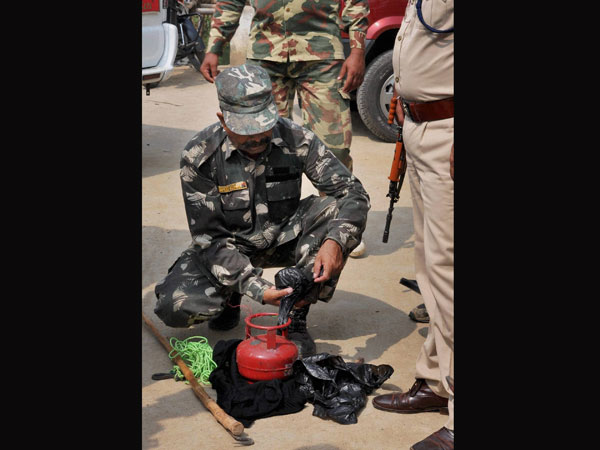 Security personnel detonating a cane bomb