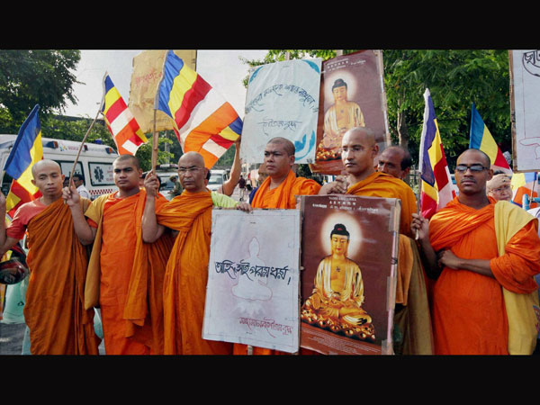 Buddhist Monks take part in a silent protest