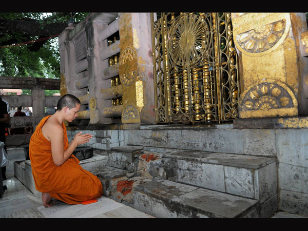 A Buddhist monk offers prayers for peace