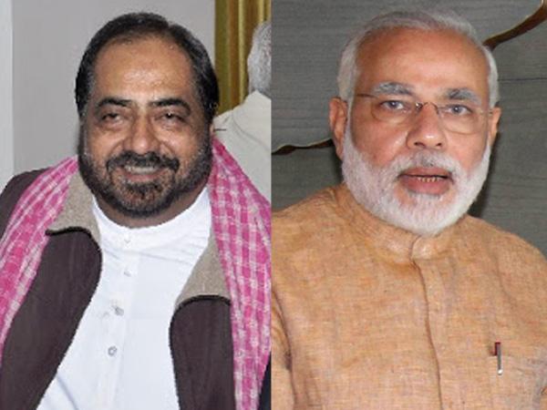 Amir Raza Husain and Narendra Modi
