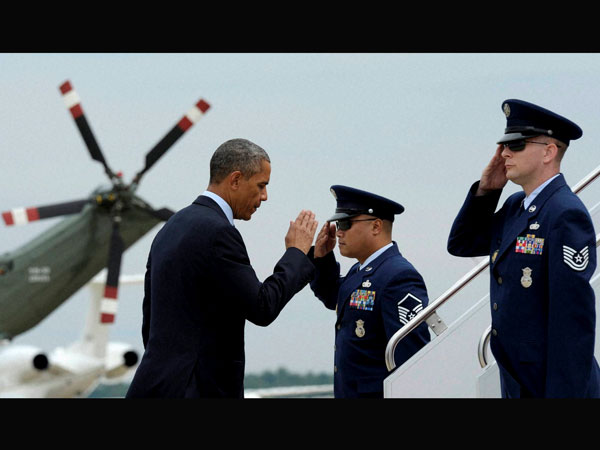 Barack Obama returns a salute