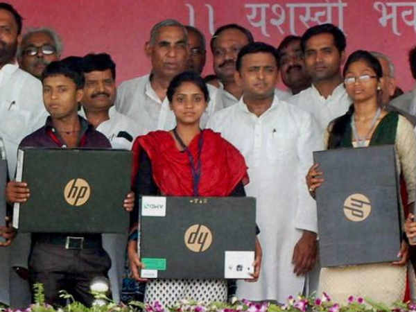 Students posing with laptops