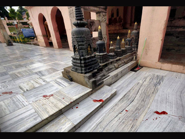 Blood lies splattered on the floor of the Mahabodhi Temple