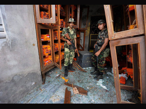 Security personnel inspect the site of blast