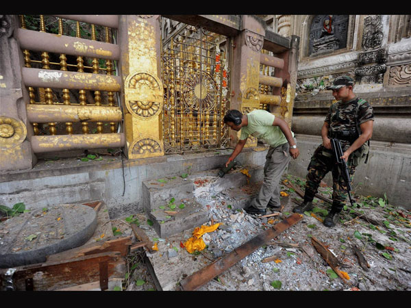 Security personnel inspecting the explosion site