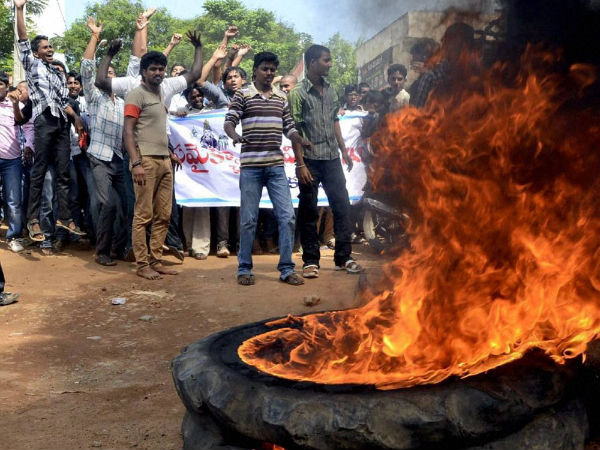 Protesters burn tyre