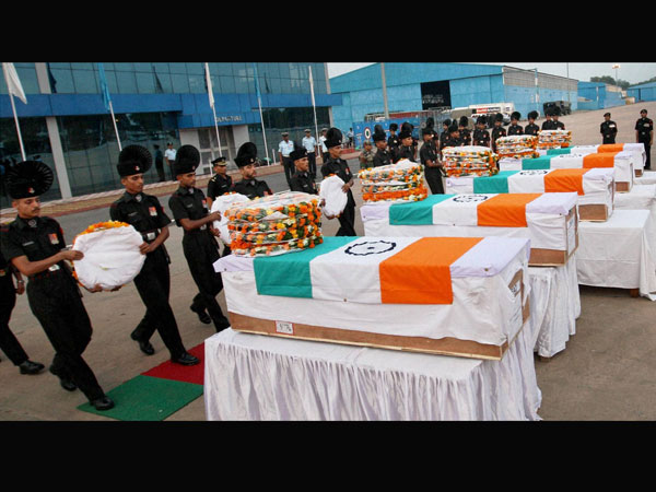 Soldiers paying tributes to five army jawans