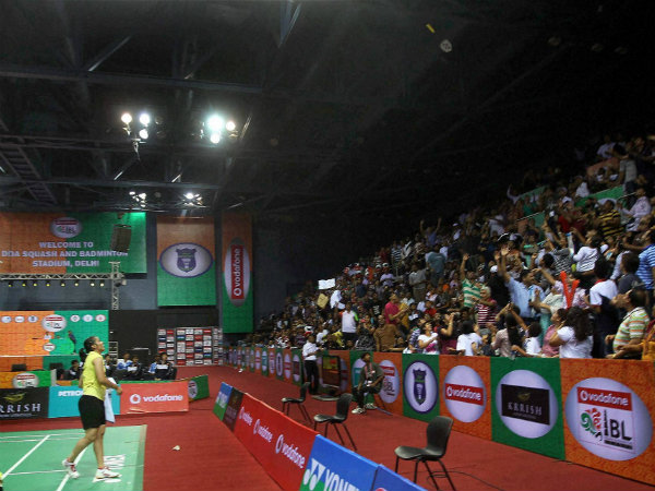 Saina Nehwal throws her raquet for the fans during IBL in New Delhi