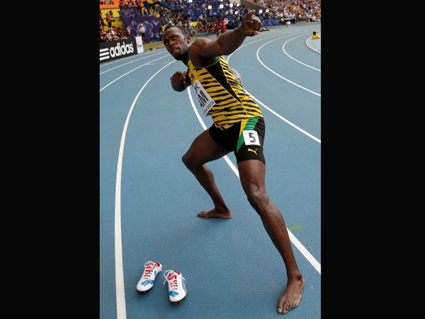 Jamaica's Usain Bolt celebrates winning his third gold medal