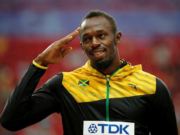 Jamaica's Usain Bolt gestures on the podium