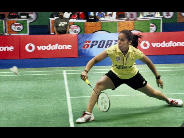 Saina Nehwal plays a shot against PC Thulasi