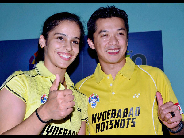 Hyderabad Hotshots team captain Saina with teammate Hidayat during a media conference at Gopichand Academy in Hyderabad on Sunday