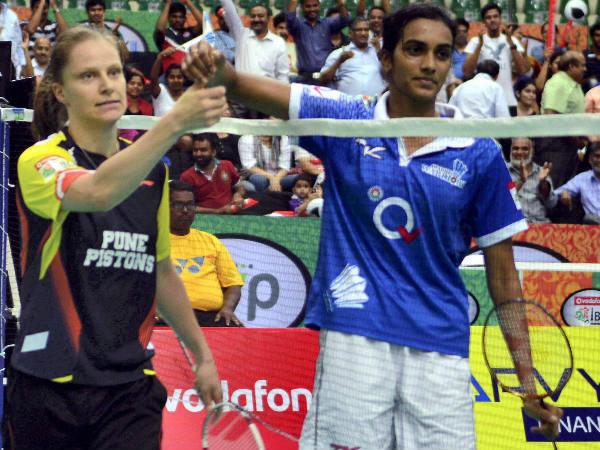 Awadhe Warriors' PV Sindhu is congratulated by Pune Pistons' Schenk Juliane