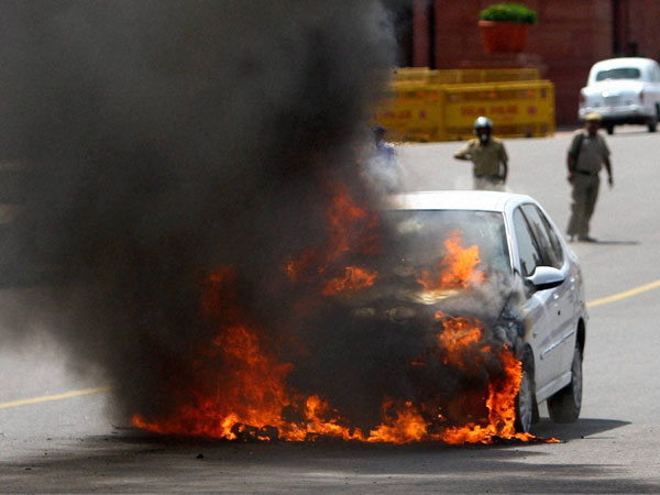Car catches fire outside Parliament
