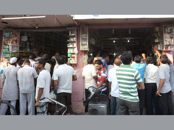 People buying medicines during the relaxed hours of curfew