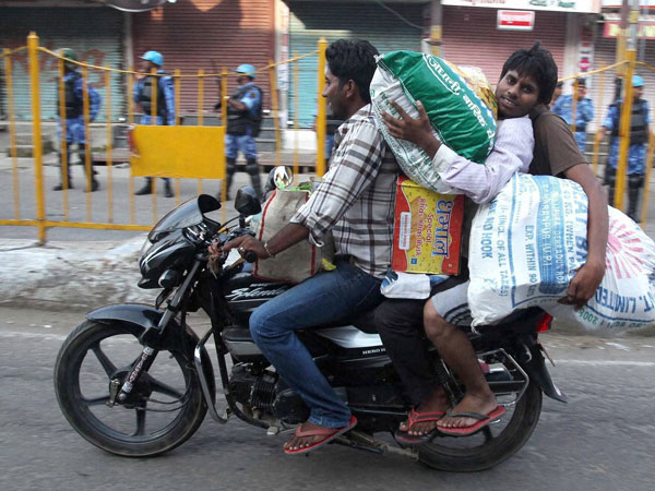 People carrying daily use commodities
