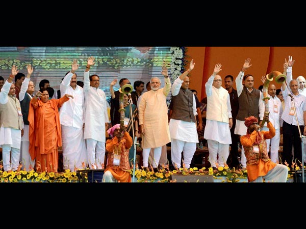 BJP leaders wave during the mega rally in Bhopal