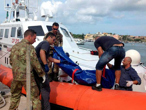 Italy shipwreck death toll rises
