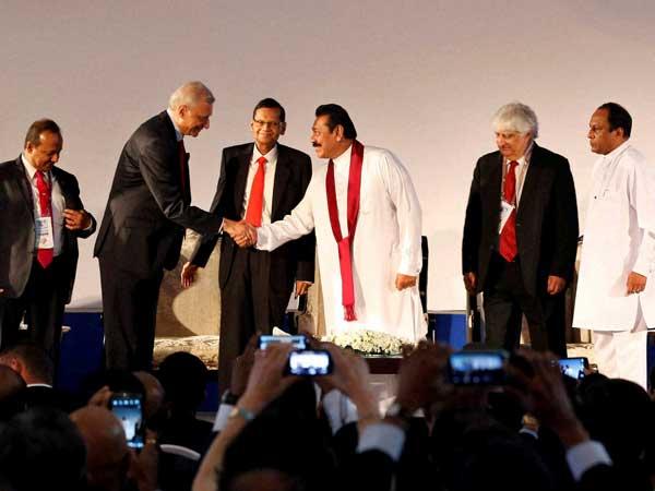 Rajapaksa happy with Khurshid's presence