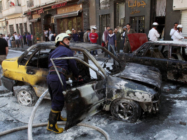 syria-cars-damaged-rocket-attack