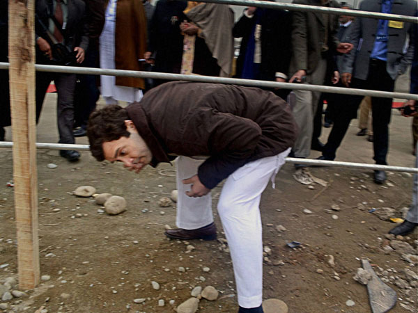 Rahul Gandhi crosses the barricade at the inauguration