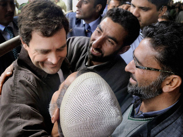 Rahul Gandhi hugs his supporters at the inauguration