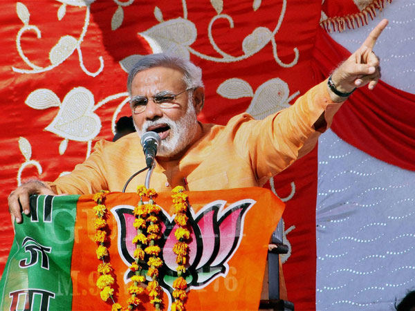 Narendra Modi takes on Cong, AAP