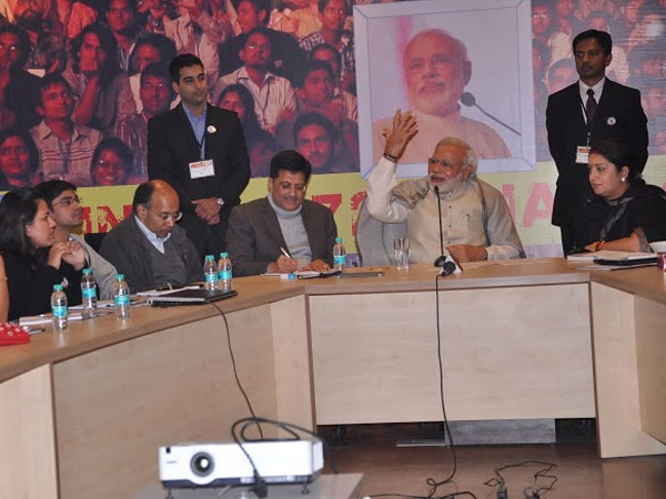 Narendra Modi interacts with volunteers