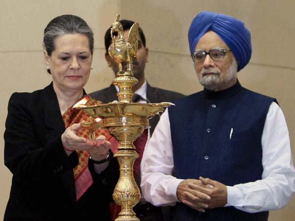 Prime Minister Manmohan Singh with UPA Chairperson Sonia Gandhi lighting the lamp