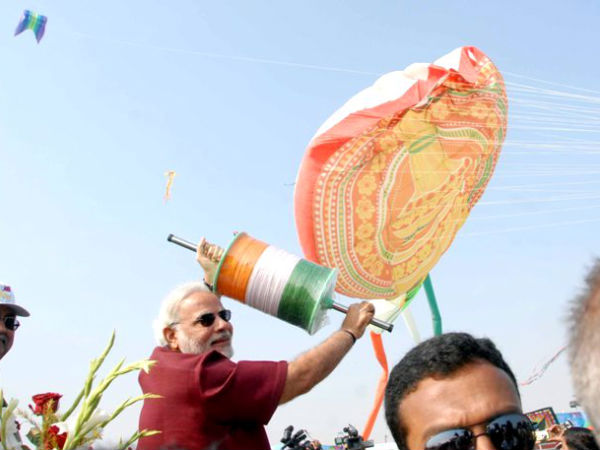 Gujarat CM Narendra Modi flies kite