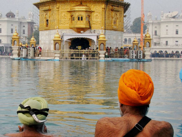 Sikh devotees take bath in the holy sarovar