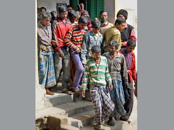 Bolpur: Balai Mardi 12 other accused being produced at a court in Bolpur on Thursday in connection with the gangrape of a tribal girl in Subalpur village.