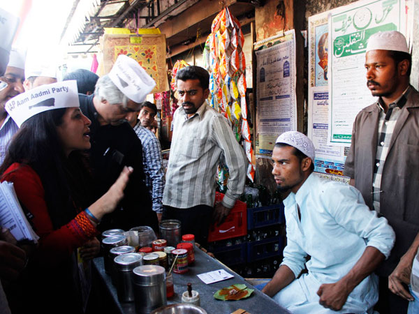 Shazia Ilmi interacting with shopkeepers
