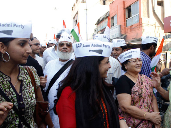 Shazia Ilmi with party workers and volunteers