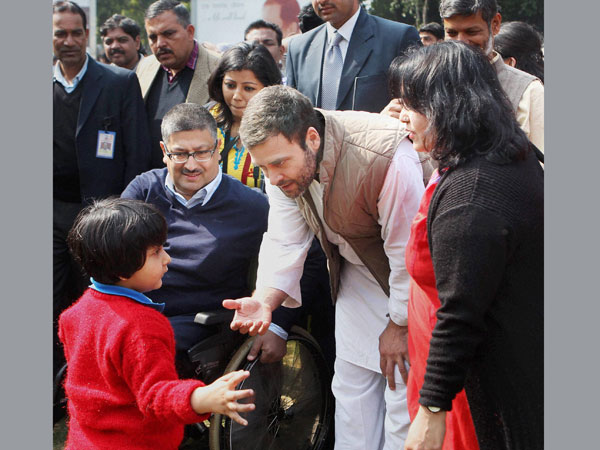 Rahul Gandhi greets a disabled child