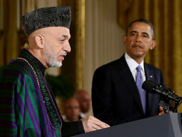 President Barack Obama listening to Afghan President Hamid Karzai