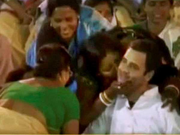 Women shower affection on Rahul Gandhi, plant kisses on his cheeks