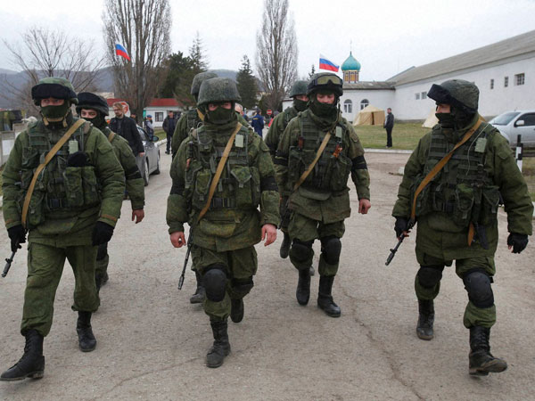Russian soldiers guard Ukraine's infantry base