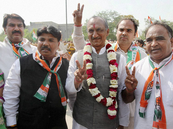J P Agarwal flashes victory sign