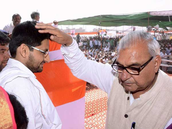 Bhupinder Singh Hooda with his son