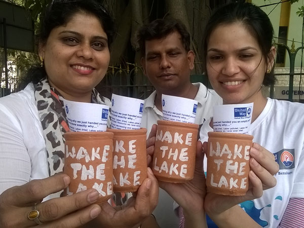 NGO distributes empty pots to mark World Water Day