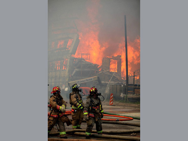 Houston firefighters see a second building catch fire