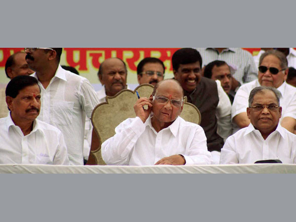 Sharad Pawar along with party leader Ganesh Naik