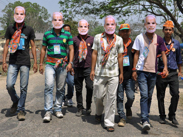 BJP supporters wear masks of party's PM candidate Narendra Modi