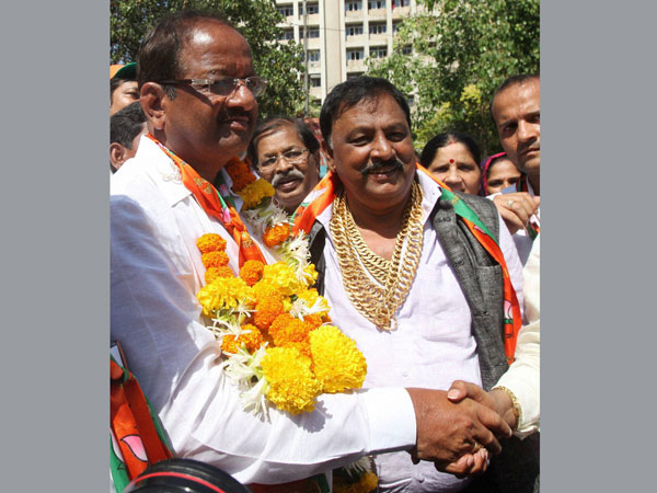 BJP leader Gopal Shetty (L) filed his nomination papers