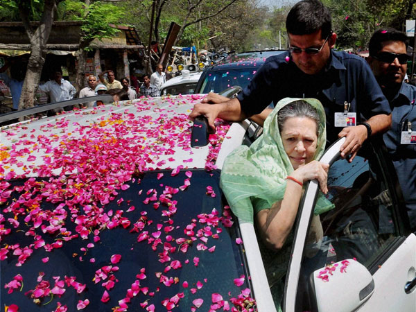 Sonia Gandhi is greeted by party workers