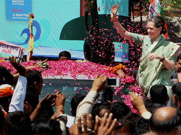 Sonia Gandhi waves to supporters