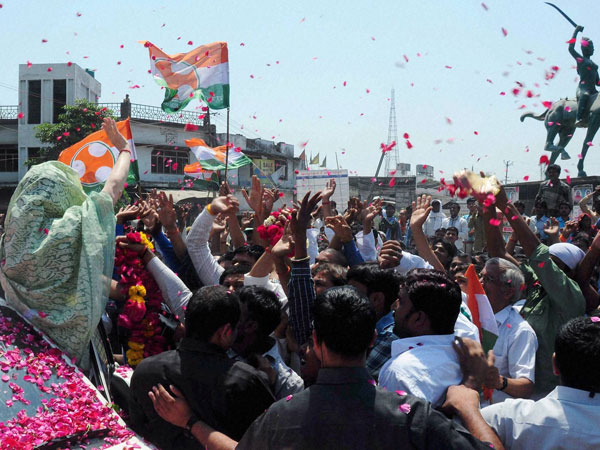 Sonia Gandhi waves to supporters during her nomination
