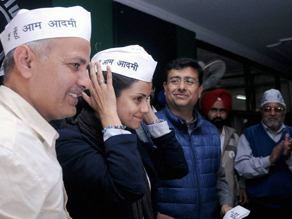 AAP leader Manish Sisodia looks on as actress Gul Panag