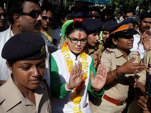 Rakhi Sawant greets her supporters after filing her nomination papers